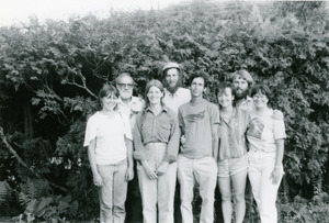 Group standing in front of greenery, including Robert Houriet (4th from left) and Stewart Hoyt and Grace Gershuny (far left)
