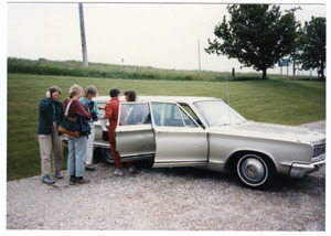 Group of women with a station wagon