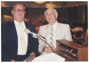 Sidney Lipshires (right) and unidentified man at dinner event