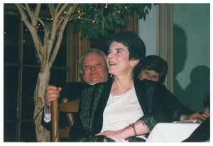 Sidney Lipshires' friend, Jan Bendall, watching a speaker at a dinner event