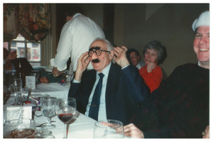 Sidney Lipshires at Congress of Connecticut Community Colleges Christmas party, wearing Groucho glasses