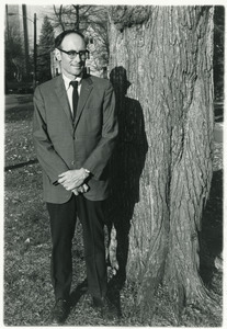 Sidney Lipshires standing in front of a tree on the Manchester Community College campus