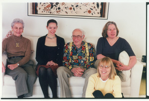 Sidney Lipshires with family and friends, seated on a couch
