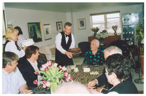 Sidney Lipshires (center) receiving a cake at a party