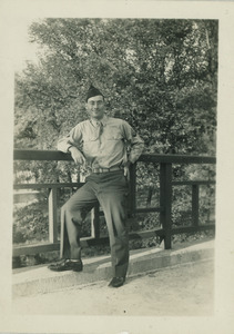 Sidney Lipshires in military uniform, posing by a bridge
