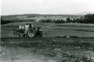 Tractor working a field in Vermont