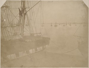 Unidentified harbor view with sailing vessels