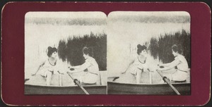Two women rowing from shore