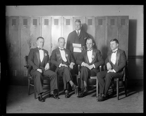 Boston Police Liquor Squad led by Oliver Garrett (second from right) dressed up in evening clothes for visits to Boston hotels on New Year's Eve.
