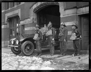 Rescue company 1 try on gas masks, R-R, William I. Kelley, Dennis J. Coughun with Dreager gas mask, Andrew Larson with Buell gas mask and Joseph Rourke with Paul gas mask, Capt. Dan J. Hurley at the wheel