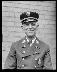 "Assistant Fire Chief of the Boston fire department Henry A. Fox.  Joined dept on Oct. 15, 1886. The photographer Les Jones was born Oct. 12, 1886: ""I was only three days old when Henry joined the Dept. We both being graduates of the Farm and Trade School."""