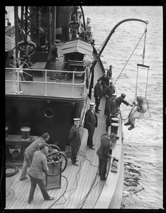 Diver on Matthew J. Boyle Engine 44. Pictured: Fire Commissioner Edward McLaughlin, Superintendent of Maintenance Edward E. Williamson, Master Marine Service John D. McDonough, Captain John E. Williams, Diver Joseph M. McCarthy.