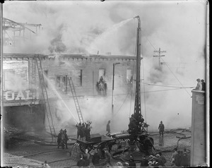 Remarkable fire at coal yard, South Boston, with water tower in action (115-F)