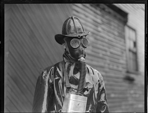 Fireman Arthur Thompkinson of Ladder 1, Chelsea, working in gas mask during two alarm rag shop fire