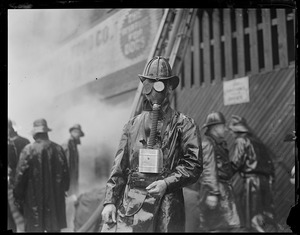 Fireman Arthur Thompkinson of Ladder 1, Chelsea, working in thick smoke at a two alarm rag shop fire