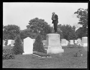 Herbert Stier of the Boston Post stands on tomb stone to make a funeral picture