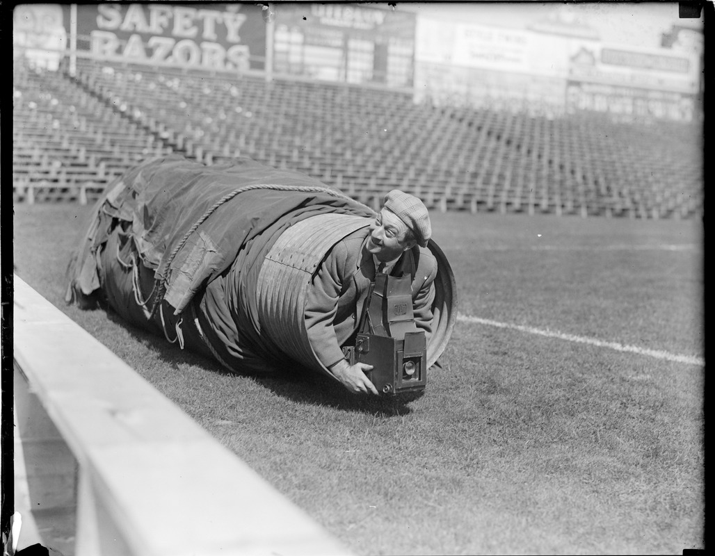 Leslie Jones with Graflex in tarp at Fenway