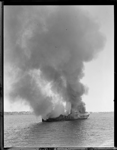 Steamer burning in Boston Harbor. Scrapping it.