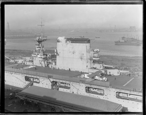 USS Lexington in dry dock with 1st plane on deck