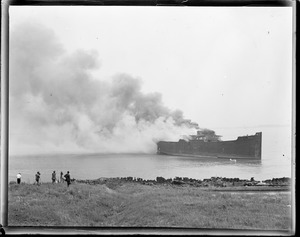 Ship burning in Boston Harbor. 'Wakanna' wooden ship off Apple Island. 'Scrapped'. Photographers on left.