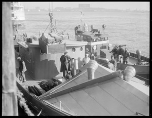 Supplies being loaded off onto boat. 1. Rum Runner 2. Coast Guard Cutter Appraisers stores - U.S. Customs Atlantic Ave.