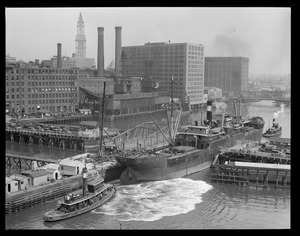 SS Evelyn, bull line sugar boat, being towed through Congress St. drawbridge