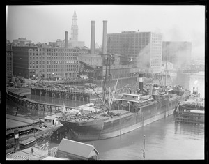 SS Evelyn , bull line sugar boat, being towed through Summer and Congress St. bridges, Fort Point Channel