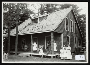 Family in front of cottage, Asbury Grove, circa 1910