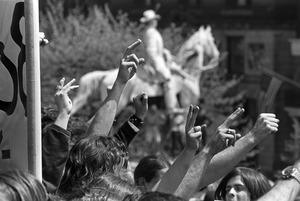 Angry fists at Kent State Massacre rally at State House, Boston