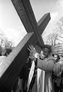 Anti-war demonstrator carries a cross, Boston Common