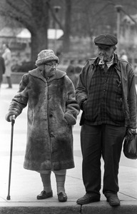 Elderly brother and sister wait to cross Park Street, Boston