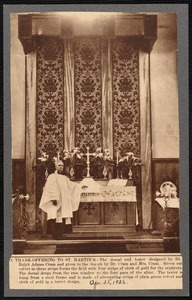 Altar of St. Martin's Church, New Bedford, MA with robed clergyman standing at left. Dossal and tester designed by Dr. Ralph Adams Cram