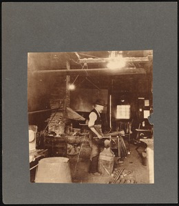 Edwin B. Macy at work in his blacksmith's shop