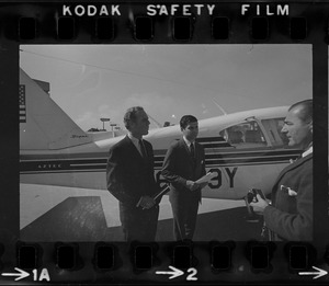 Gubernatorial nominee Kevin White and his running mate Michael Dukakis board plane at Logan Airport for a campaign trip around the Bay State