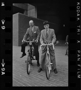 Boston's Park Comr. Joseph Curtis and heart specialist Dr. Paul Dudley White, at City Hall Plaza. They're ready to lead a dozen bicycle enthusiast on a two-mile downtown tour