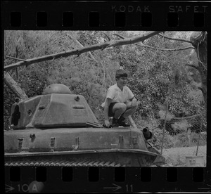 Boy posing on tank, Israel