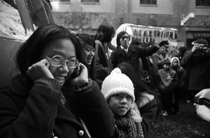 Youngsters cover ears as fireworks explode on Chinese New Year, Chinatown, Boston