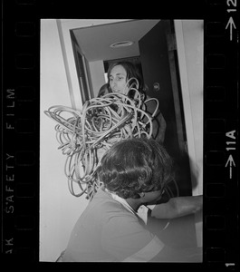Man with rappelling rope in Ruedi Wyrsch's room at Sheraton Boston