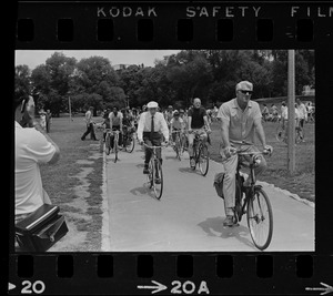 Dr. Paul Dudley White and cyclists on Cyclist Day in Boston Common
