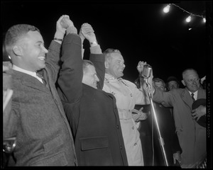 Henry Cabot Lodge, Jr. holding raised hands with John A. Volpe and two other men