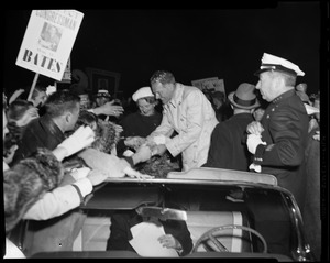 Henry Cabot Lodge, Jr. greeting supporters from the car, with his wife Emily