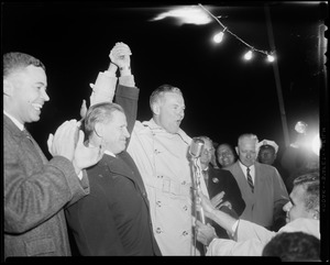 Henry Cabot Lodge, Jr. holding raised hands with gubernatorial candidate John A. Volpe at Beverly airport