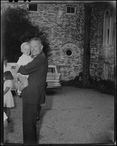 Henry Cabot Lodge, Jr. holding grandson outside his Beverly home