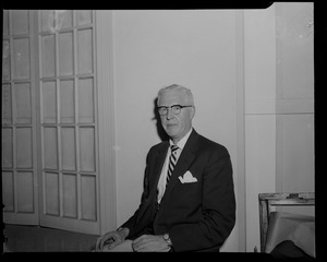 Man with glasses, seated, possibly New Bedford journalist Earle D. Wilson