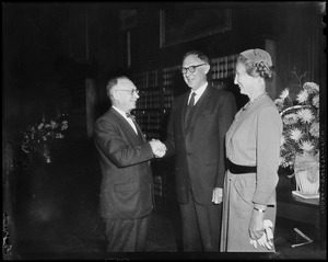 Arthur E. Whittemore, prominent Boston trial lawyer, formally seated as associate justice of the Supreme Judicial Court of Massachusetts yesterday, is shown with his wife being congratulated by Justice Felix Forte, left