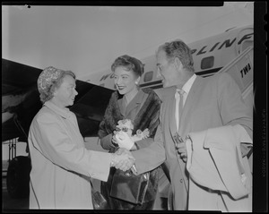 """Amanda Blake """"Kitty"""" and Milburn Stone """"Doc"""" are greeted by Miss Elizabeth Storer of Needham, Mass., a member of the 3rd Annual Cerebral Palsy Telethon Committee"""