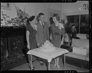 Tenley Albright, with man and woman, cutting cake decorated with figure skates