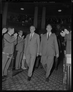 Under Secretary of State W. Averell Harriman walking down aisle of Massachusetts State House with others to applause
