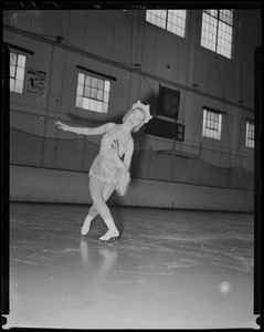 Barbara Ann Scott skating in costume at ice rink