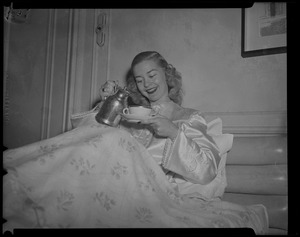 Barbara Ann Scott with teacup in hotel room at Copley Plaza